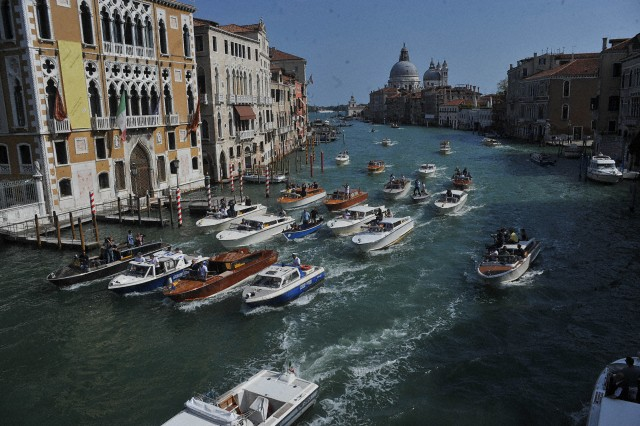 George Clooney and Amal Alamuddin on boat in Venice