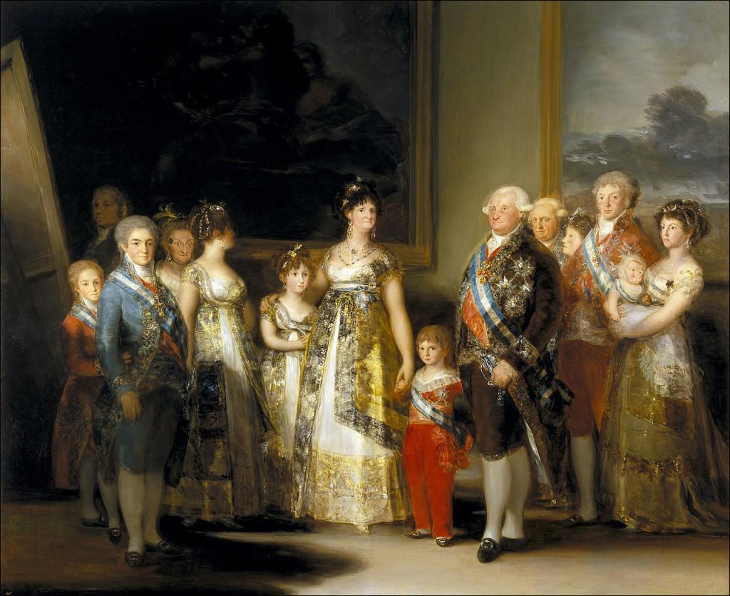 """Observem que a obra lembra """"As Meninas"""" (de Velázquez): todo clã veio visitar o artista, que está pintando numa das galerias do palácio: Goya está lá atrás, no canto superior esquerdo. Como nas obras iniciais, quadros sombrios estão dependurados atrás do grupo e a luz penetra pela lateral."""